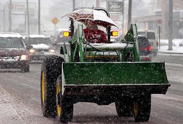 Tractor in rain snow mix