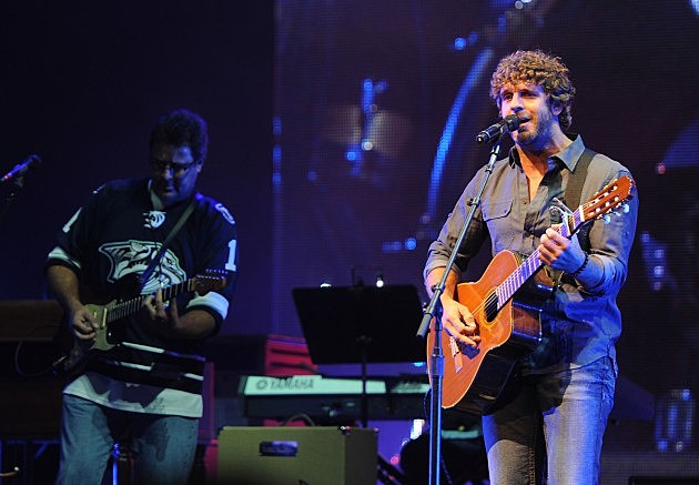 Vince Gill and Billy Currington perform onstage