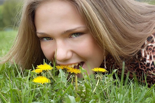 Girl Eating Dandelion